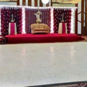 White marble style dance floor in this colorful event space.