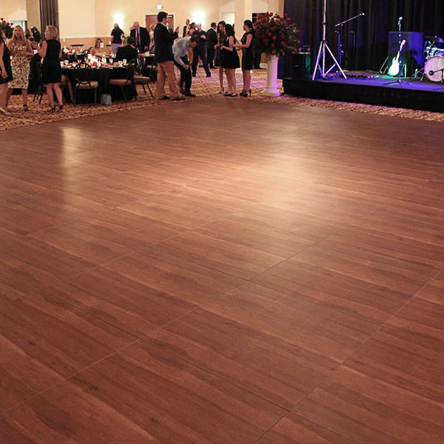 Dark Maple dance floor at a wedding with band