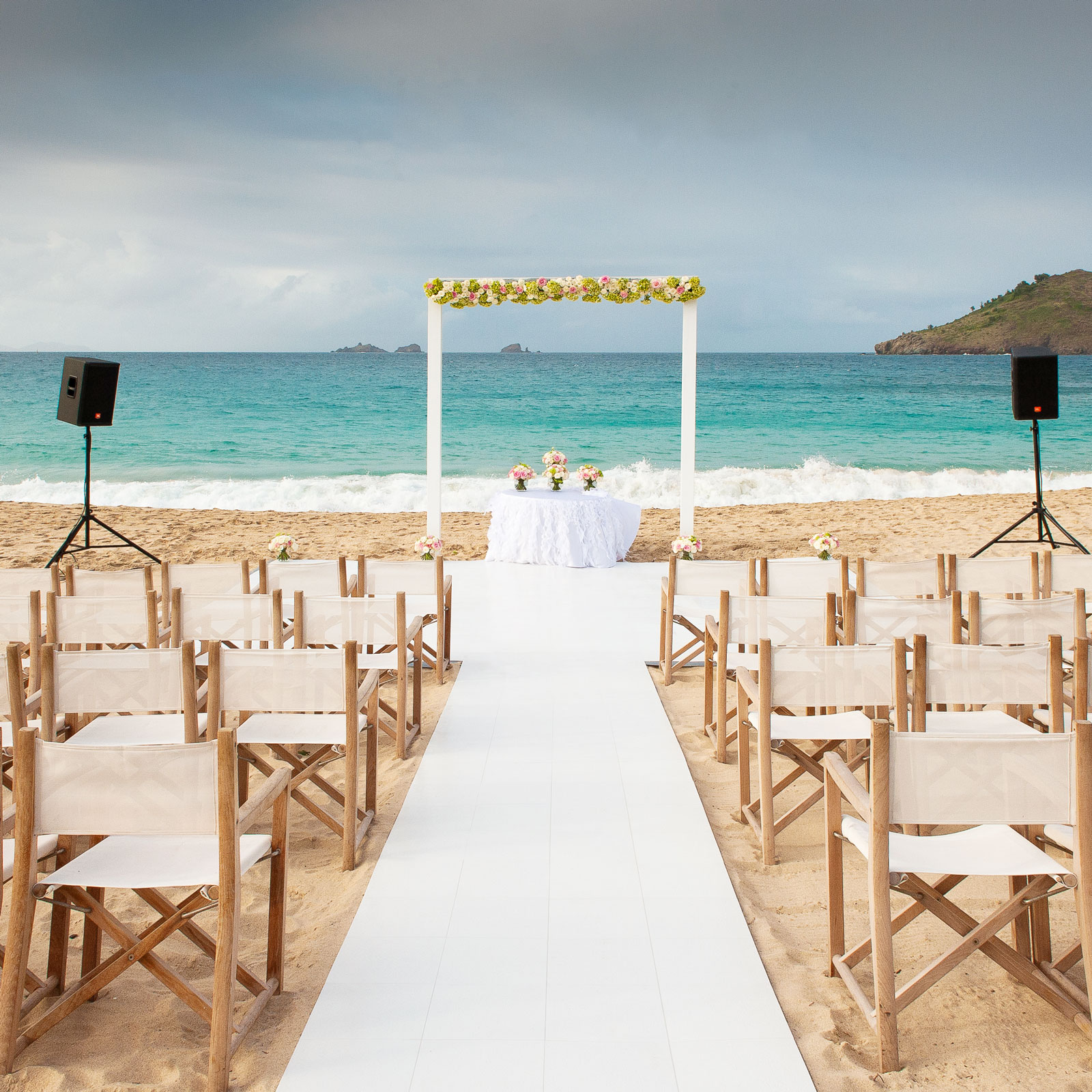 Destination wedding with Slate White flooring over a base floor on sand