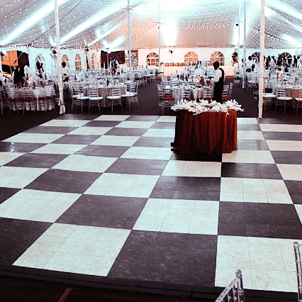 Luxury Black and White Marble dance floor at a tent event.