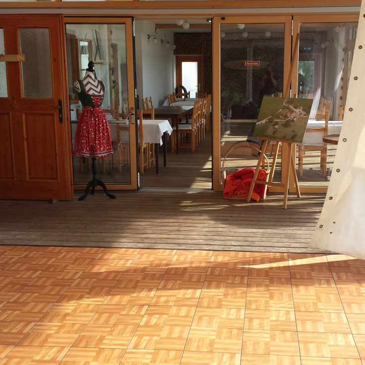 Oak flooring next to a restaurant