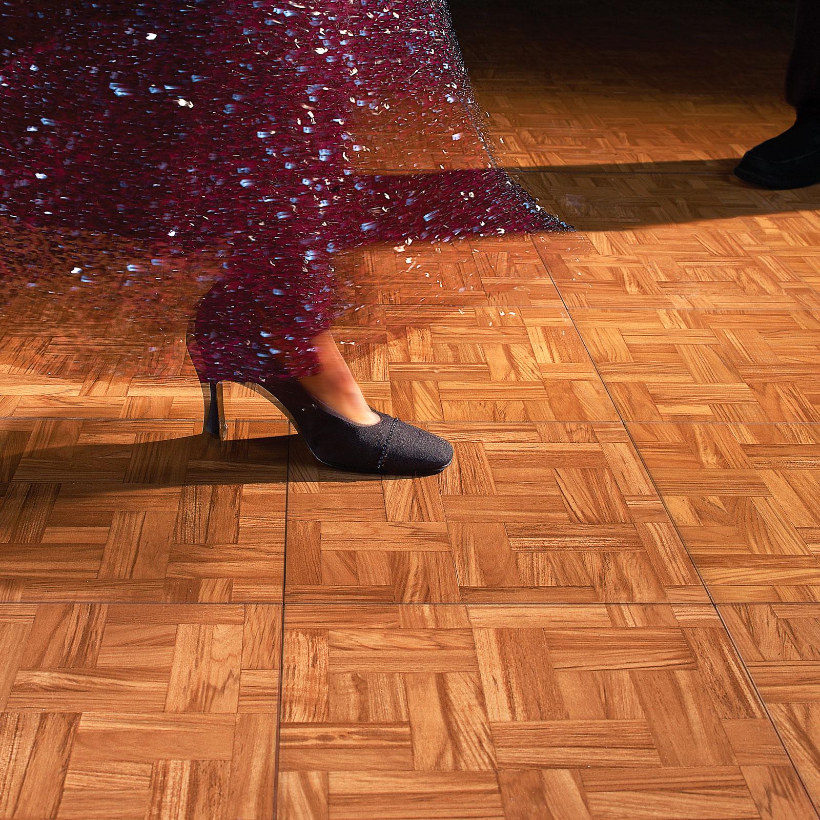 Tango dancers on a Teak Dance Floor